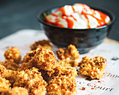 Corn-fed Chicken Popcorn and Sriracha Sour Cream