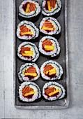 Maki sushi with salmon and mango
