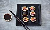 Maki sushi with brown rice and salmon