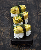 Nigiri sushi with a herb omelette