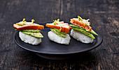 Nigiri sushi with salmon and avocado
