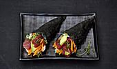 Temaki sushi with tuna fish and avocado