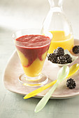 Orange smoothie with mango and blackberries