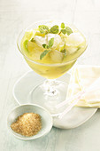 Apple smoothie with ice and mint leaves
