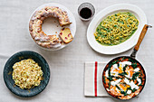 Strawberry and lemon ricotta cake, courgette noodles with pesto, linguine with leeks and curry, and courgette with rocket and eggs