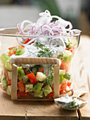 Summer salad with cucumber, peppers, apple and quark dressing