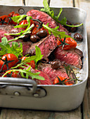 Tagliata with tomatoes, olives and rocket (Italy)