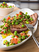 Tuna steak with pea and mint salsa