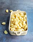 Fresh gnocchi in ceramic bowl
