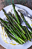 Grilled green asparagus on ricotta cream