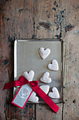 Heart-shaped iced biscuits and gift tag