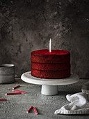 red velvet naked cake with candles on the table