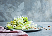 Green salad with apple and nuts