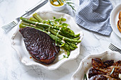 Cooked black angus prime beef steak with asparagus and cream mustard sauce