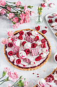 Raspberry tart with mascarpone, ruby chocolate and meringues
