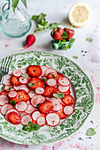 Salad with radish, strawberries, mint and pepper