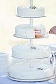 Four-tier white wedding cake