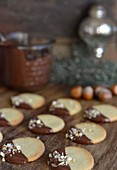 Cookies with chocolate icing and chopped hazelnuts