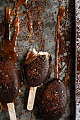 Caramel and chocolate ice cream bar on a metal tray