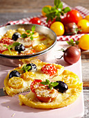 Mini potato pies with cherry tomatoes and olives
