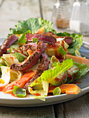 Papaya salad with beef steak