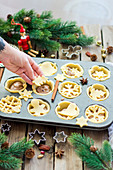 Christmas tarts with nut filling and cranberries