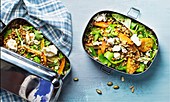 Vegetable salad with lentils, pumpkin and feta in a lunch box