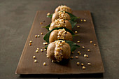 Mushrooms with a ricotta and mint filling and roasted almonds