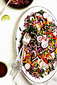 Kale salad with radicchio, radishes, carrots and pepper