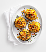 Gratinated portobello mushrooms with a bulgur and chickpea filling