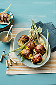 Grilled sweetcorn wrapped in bacon with a honey marinade