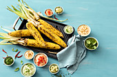 Grilled corn with various dips