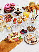 A brunch buffet featuring sweet and savoury dishes