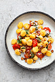 Gnocchi with cherry tomatoes and hazelnuts
