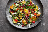 Roast potato salad with peppers, courgette and feta cheese