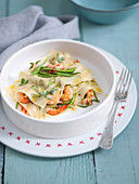 Shrimp lasagna with herb noodle plates and julienne cut zoodles