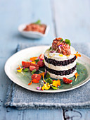 Mozzarella rice tower with almond and tomato cream