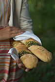 Woman carrying herb filled bread