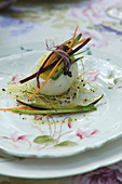 Egg stuffed with bottarga on sprouts with julienne vegetables