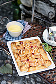 Apple tart with cream and raspberries
