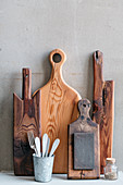 Wooden board collection in front of a gray wall