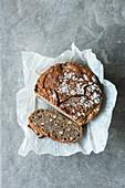 No-knead hazelnut bread, sliced on a piece of paper