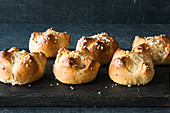 Creme fraîche rolls with pistachio nuts and sugar nibs