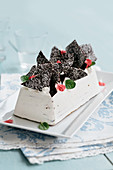 Vanilla ice cream cake with chocolate and hazelnuts