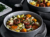 Cabbage stew with pumpkin and Mettenden (smoked pork sausage)