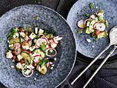 Kohlrabi salad with peas and feta cheese
