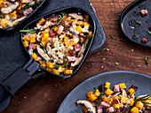 Pumpkin raclette with mushrooms