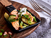 Salmon raclette with potatoes and courgette