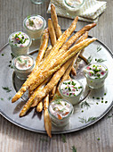 Homemade pretzel sticks with egg, bacon and salmon dips