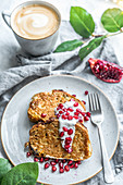 French toast with yogurt and pomegranate served with coffee